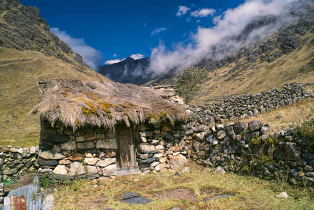 Traditional old stone hut in Andes mountains in Bolivia on Choro trek
