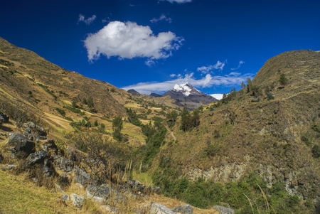 alpamayo: Picturesque green canyon in between hills of Peruvian Andes Stock Photo