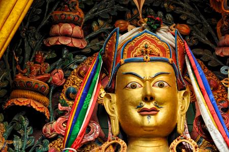 deity: Decorated golden statue of buddhist deity in Nepal Stock Photo