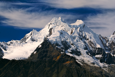 Majestic Alpamayo, one of highest mountain peaks in Peruvian Andes, Cordillera Blanca Stock Photo