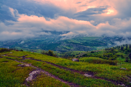 Stormy clouds above green landscape of mountainous Karabakh photo
