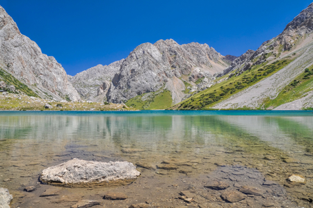 crystal clear: Crystal clear lake in mountain range Tien-Shan in Kyrgyzstan Stock Photo