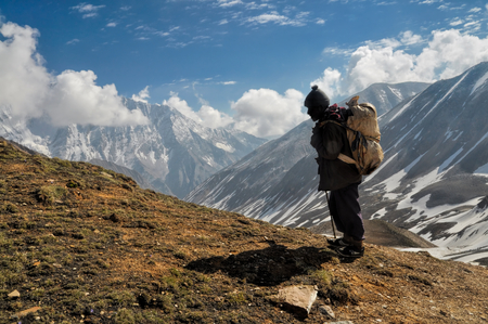 Sherpa in picturesque Himalayas mountains in Nepal