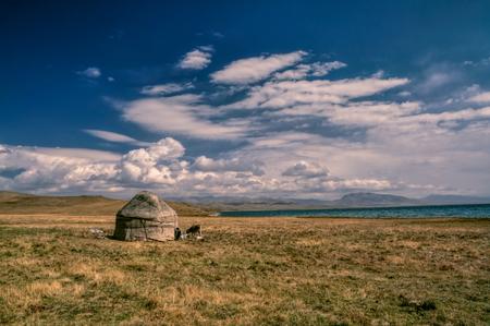 lake dwelling: Traditional yurt of nomadic tribe on green grasslands in Kyrgyzstan