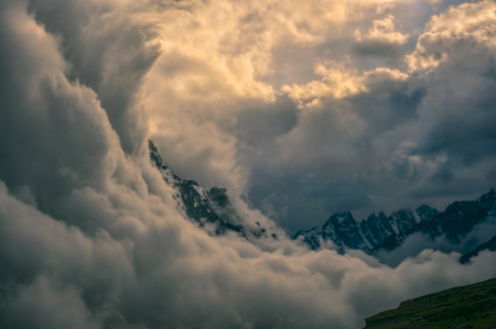 mountain valley: Dramatic storm clouds over Kangchenjunga mountains in Nepal Stock Photo