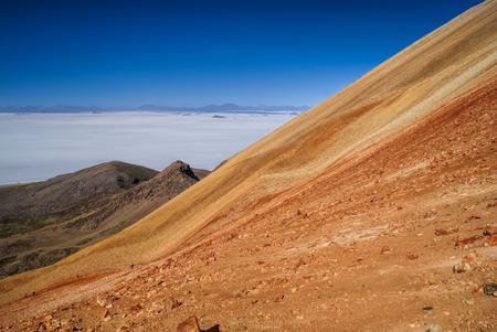 vast: Picturesque view of vast white salt plane Salar de Uyuni from colored mountains Stock Photo