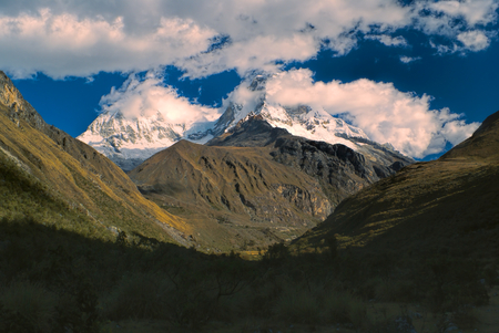 ancash: Majestic mountain Huascaran in Andes with its two peaks in clouds, highest mountain in Peru, South America