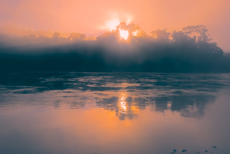 Mystical sunrise above lake in bolivian Andes
