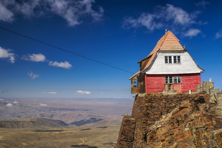 Wooden hut on the edge of cliff on mountain Chacaltaya in south american Andes Editorial