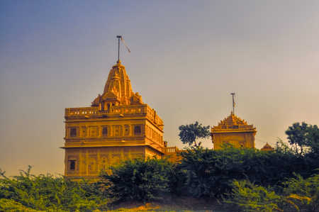 thar: Picturesque view of temple in Thar Desert illuminated by the setting sun