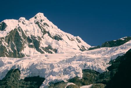 Majestic peak covered by snow in Peruvian Andes, Cordillera Blanca