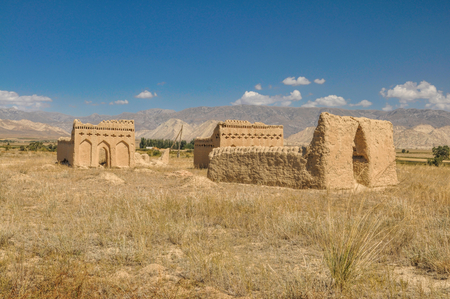 tien shan: Ruins of ancient temple on arid landscape in Kyrgyzstan