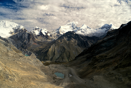 Deep canyons around Alpamayo, one of highest mountain peaks in Peruvian Andes, Cordillera Blanca