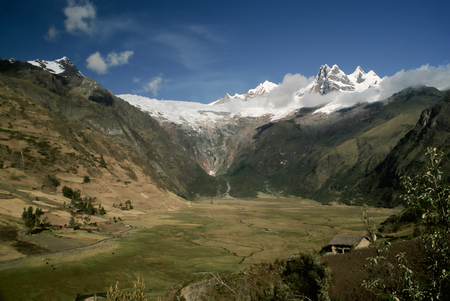 Scenic green valley in between high peaks of mountains in Peruvian Andes