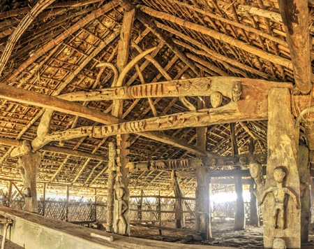 dwelling: Interior of a traditional wooden dwelling with carved symbols in India