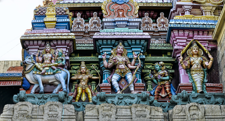 Detail of colorful tower of Meenakshi Amman Temple in India photo