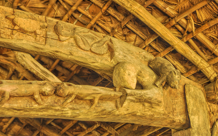 dwelling: Interior detail of a traditional wooden dwelling with carved symbols in India Stock Photo