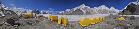 Scenic panorama of tents on Engilchek glacier in picturesque Tian Shan mountain range in Kyrgyzstan photo