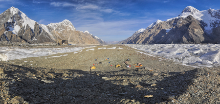 Scenic panorama of base camp on Engilchek glacier in picturesque Tian Shan mountain range in Kyrgyzstan photo