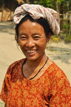 Nagaland, India - March 2012: Joyful woman smiles on camera in Nagaland, remote region of India. Documentary editorial.