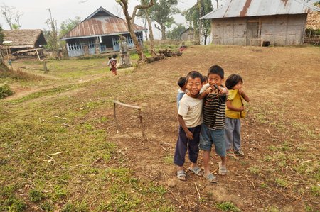 nagaland: Nagaland, India - March 2012: Group of playful small kids in Nagaland, remote region of India. Documentary editorial. Editorial