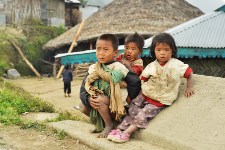 Nagaland, India - March 2012: Poor children on the street of village in Nagaland, remote region of India. Documentary editorial.
