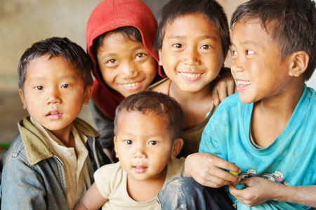 Nagaland, India - March 2012: Group of happy children in Nagaland, remote region of India. Documentary editorial.