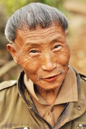 nagaland: Nagaland, India - March 2012: Portrait of an old man smiling at camera in Nagaland, India. Documentary editorial.