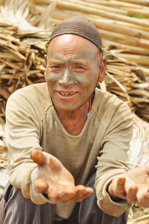Nagaland, India - March 2012: Man with traditional painted face in Nagaland, remote region of India. Documentary editorial.