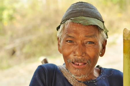 Nagaland, India - March 2012: Old man smiles at camera in Nagaland, remote region of India. Documentary editorial. Editorial