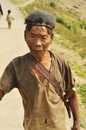 Nagaland, India - March 2012: Elder man with painted face in Nagaland, remote region of India. Documentary editorial. Editorial