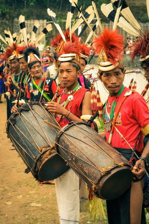 documentary: Mon, Nagaland - April 2012: Photo of young boys in traditional costumes and hats playing drums during dance performance at Aoleang festival in Mon, Nagaland. This festival showcases rich cultural heritage of this country. Documentary editorial.