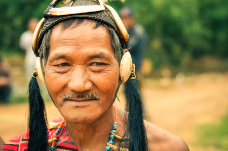 documentary: Mon, Nagaland - April 2012: Photo of man with traditional hat posing to photocamera at Aoleang festival in Mon, Nagaland. At this festival people can see indigenous dances and games. Documentary editorial.