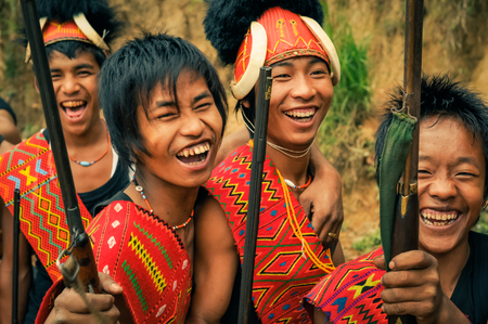 documentary: Mon, Nagaland - April 2012: Young boys in colourful costumes smiling at traditional Aoleang festival in Mon, Nagaland. Documentary editorial.