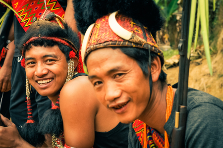 documentary: Mon, Nagaland - April 2012: Sitting men smile to photocamera at traditional Aoleang festival in Mon, Nagaland. At this festival people perform indigenous dances, songs and games. Documentary editorial.