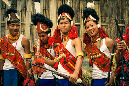 documentary: Mon, Nagaland - April 2012: Young boys in costumes and hats made of fur stand in row and smile at Aoleang festival in Mon, Nagaland. This festival showcases rich cultural heritage of this country. Documentary editorial.