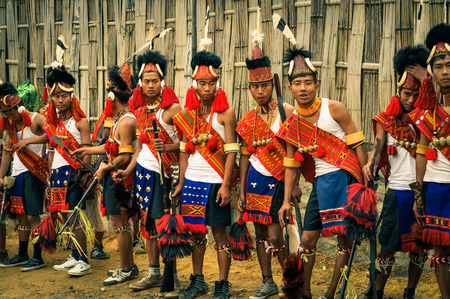documentary: Mon, Nagaland - April 2012: Young performers in costumes and hats stand in row at Aoleang festival in Mon, Nagaland. This festival showcases rich cultural heritage of this country. Documentary editorial.