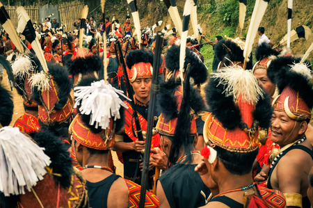 Mon, Nagaland - April 2012: Crowd of people in traditional costumes at Aoleang festival in Mon, Nagaland. At this festival people can see indigenous dances and games. Documentary editorial.