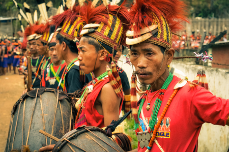 documentary: Mon, Nagaland - April 2012: Photo of young boys in traditional costumes and hats standing in row and holding drums during performance at Aoleang festival in Mon, Nagaland. This festival showcases rich cultural heritage of this country. Documentary editori