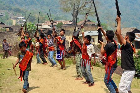 nagaland: Aoleang, Nagaland, India - April 2012:  Native boys with long rifles dancing and singing during Aoleang festival in Aoleang, Nagaland, India. Documentary editorial.