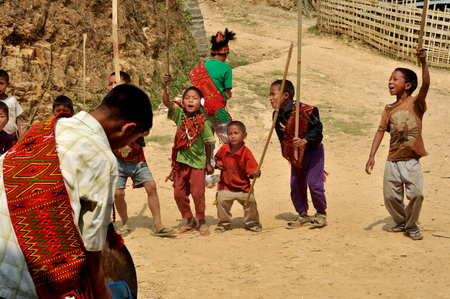 nagaland: Aoleang, Nagaland, India - April 2012:  Small boys with sticks and guns walking on the street during Aoleang festival in Aoleang, Nagaland, India. Documentary editorial.
