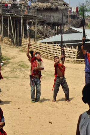 nagaland: Aoleang, Nagaland, India - April 2012:  Native boys with weapons dancing and singing during Aoleang festival in Aoleang, Nagaland, India. Documentary editorial.