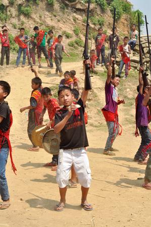 nagaland: Aoleang, Nagaland, India - April 2012:  Native boys with rifles dancing and singing during Aoleang festival in Aoleang, Nagaland, India. Documentary editorial.