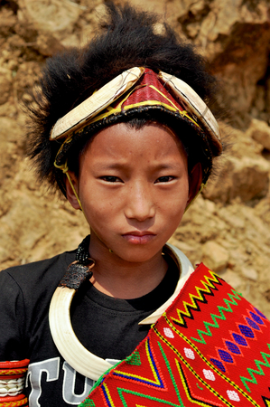 nagaland: Aoleang, Nagaland, India - April 2012: Young indian boy in traditional warrior costume during Aoleang festival in Aoleang, Nagaland, India. Documentary editorial. Editorial