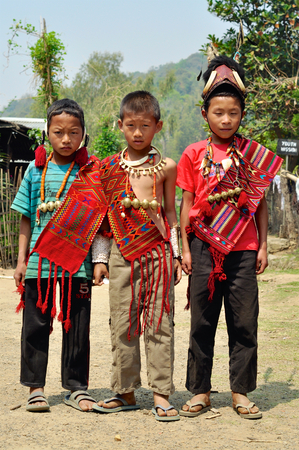 nagaland: Aoleang, Nagaland, India - April 2012:  Young boys in traditional  costume during Aoleang festival in Aoleang, Nagaland, India. Documentary editorial. Editorial