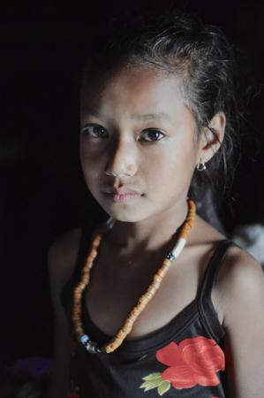nagaland: Aoleang, Nagaland, India - April 2012:  Portrait of native girl in Aoleang, Nagaland, India. Documentary editorial. Editorial