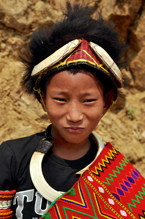 nagaland: Aoleang, Nagaland, India - April 2012: Confident native boy in traditional warrior costume during Aoleang festival in Aoleang, Nagaland, India. Documentary editorial. Editorial