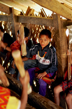 nagaland: Aoleang, Nagaland, India - April 2012:  Boys singing during Aoleang festival in Aoleang, Nagaland, India. Documentary editorial.