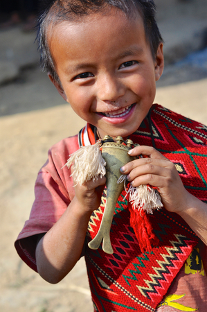 nagaland: Aoleang, Nagaland, India - April 2012:  Smiling native boy dressed as warrior during Aoleang festival in Aoleang, Nagaland, India. Documentary editorial. Editorial