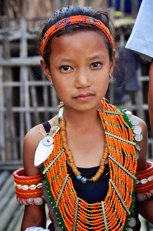 nagaland: Aoleang, Nagaland, India - April 2012:  Small girl in traditional costume during Aoleang festival in Aoleang, Nagaland, India. Documentary editorial.